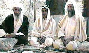 Muhammed Atef (L) sits with Osama Bin Laden (R) and Bin Laden's son Mohammed (C) during his marriage to Atef's daughter