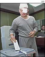 A hospital patient voting on 16 November