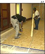 Workmen seal a corridor in the Dirksen Senate Office building