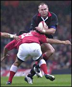 Skipper Scott Quinnell goes on the charge