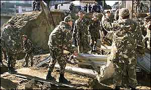 Algerian soldiers help clear the debris in the Bab El Ooued district of Algiers