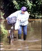Cyclist in flood   PA
