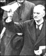 Neville Chamberlain holds aloft the peace treaty bearing Hitler's signature, PA