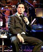 The BBC has apologised for the language during a Robbie Williams concert
