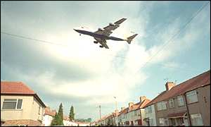 A plane flies over houses near Heathrow