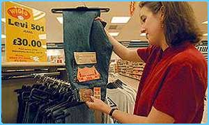 A customer looks at Levi's jeans in Tesco