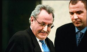 Jonathan King leaves the Old Bailey at the start of his first trial