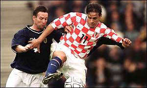 Bosko Balaban of Croatia and Aston Villa is tackled by Scotland's Paul Lambert