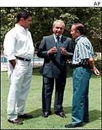 Carlos Menem with brother Eduardo, centre, and nephew Adrian, right while the former president was under house arrest