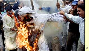A crowd in New Delhi burns an effigy of match referee Mike Denness