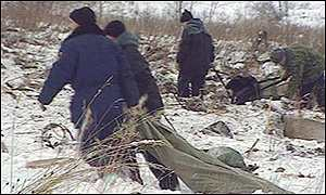 Rescuers working on the crash site of the Ilyushin-18 plane