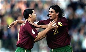 Nuno Gomes and Sergio Conceicao of Portugal