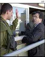 Palestinians at an Israeli checkpoint