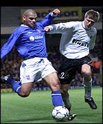 Ipswich Town's Jermaine Wright tries to shoot pass Milan's Vratislav Gresko