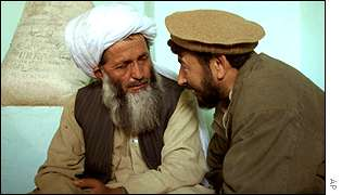 A Northern Alliance commander talks to a Taleban commander