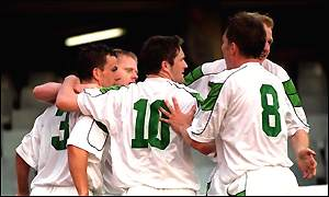 Matt Holland, Robbie Keane and Ian Harte celebrate an Ireland goal