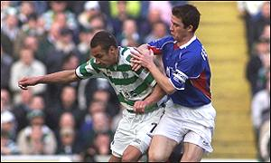 Henrik Larsson shields the ball from Barry Ferguson