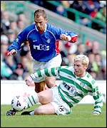 Celtic's Neil Lennon stops de Boer in his tracks