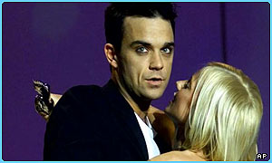 Happier times? Robbie and Geri at the Brits