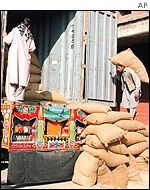 Workers load a truck with WFP aid in Peshawar