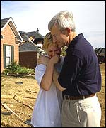 Governor Ronnie Mugrove comforts a resident in Madison, Mississippi