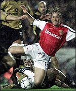 Ray Parlour tumbles under the challenge