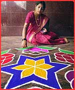Girl making Rangoli patterns