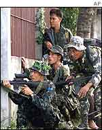 Philippines military shoot at the rebels' complex