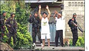 The hostages, their hands tied together, outside Nur Misuari's complex