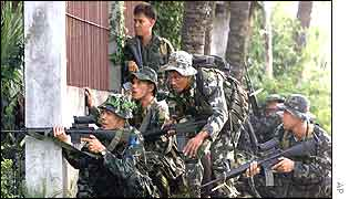 Philippines troops take up their positions outside the base