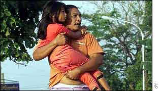 A man flees with his daughter