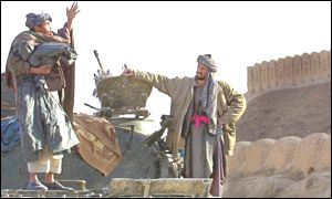 Northern Alliance soldier gestures during battle at Qala-e-Jhangi fortress