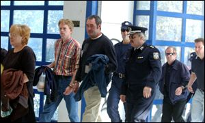 Unidentified members of the group arrive in court