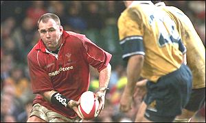 Scott Quinnell takes on the Australia defence