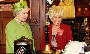 The Queen went behind the bar at the Queen Vic pub