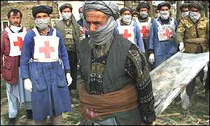 Local Red Cross workers arrive to remove bodies from fort near Mazar-e-Sharif