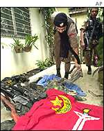 A flag and weapons left behind by guerrillas