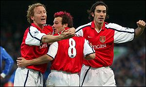 Fredrik Ljungberg (centre) celebrates his goal with Ray Parlour and Robert Pires