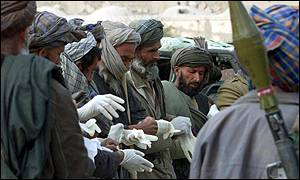 Afghan men prepare to recover the bodies of the Taleban fighters