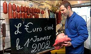 French butcher displays announcement that the euro will be introduced on 1 January, 2002