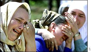 Bosnian Muslim women at a service for victims of the Srebrenica massacre