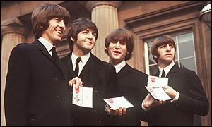 Harrison (left) was awarded an MBE with band members in 1965