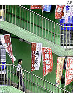 Man walks down steps covered with campaign flags