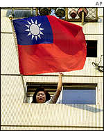 Woman waves Republic of China flag from her window during the election campaign