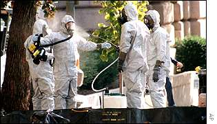 Anthrax investigators hose down outside the Capitol
