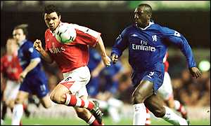 Chelsea's Jimmy Floyd Hasselbaink (right) tries to get past Charlton defender Mark Fish