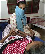 An aids patient consoles her friend who is in the final stages of the disease