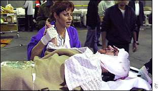 A woman comforts one of the injured