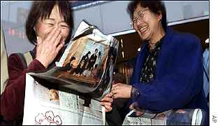 Japanese women read of the birth