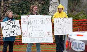 Protesters demonstrate against the test outside Vandenberg Air Base